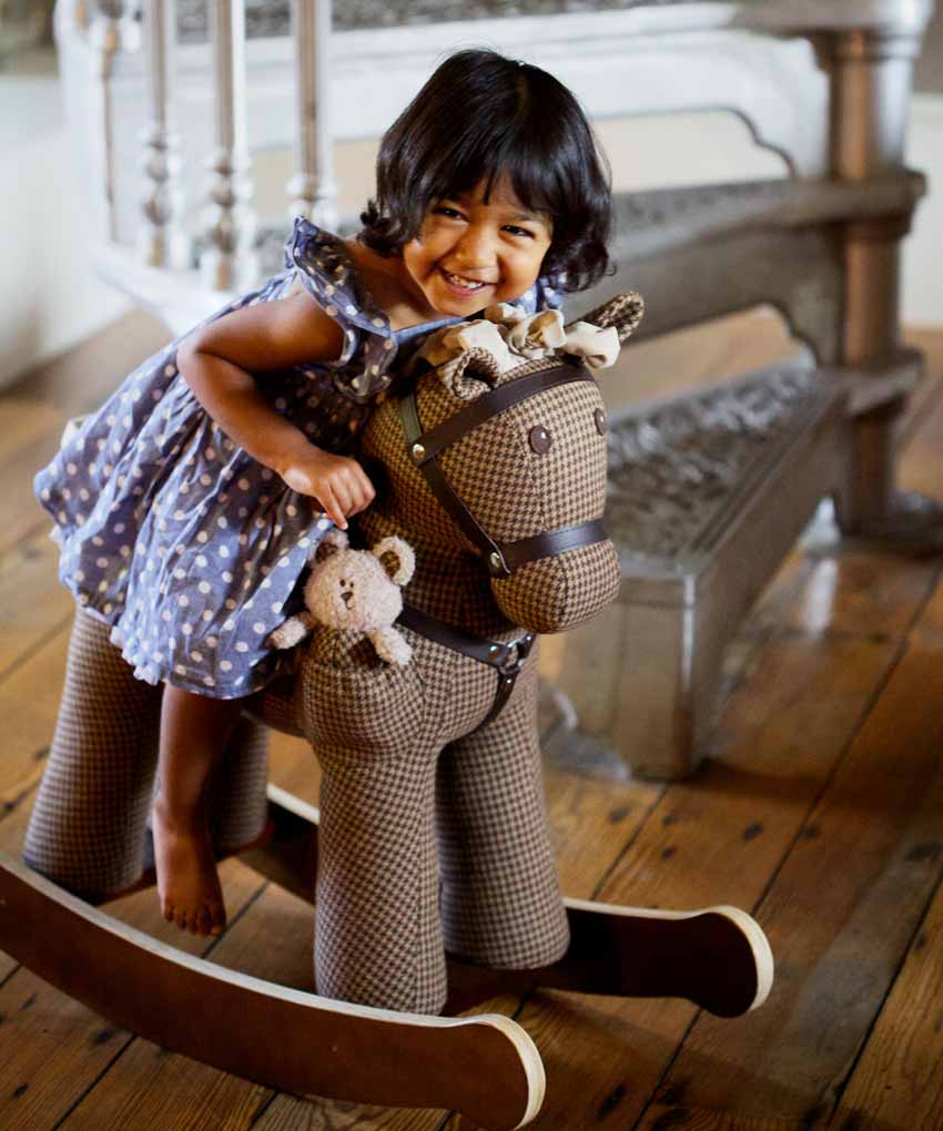 Little Girl on Chester & Fred Rocking Horse